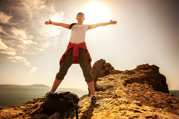 tourist is enjoying view with outstretched arms