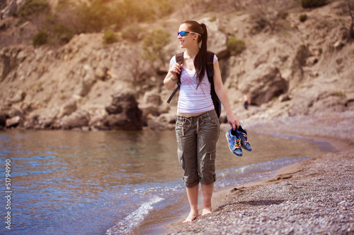 girl is walking along the beach. tourism
