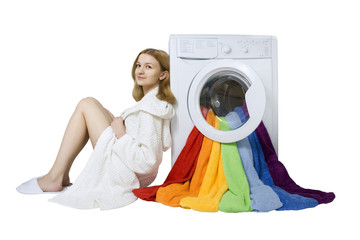 Beauty young girl and washing machine with colorful things to wa