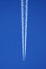 airplane and vapour trail