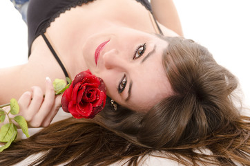 Beaty girl and rose. Nose piercing and red lips.