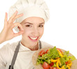 Attractive cook woman showing ok