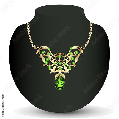 of a necklace with emeralds and precious stones and earrings