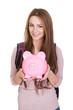 Female Student Holding Piggybank