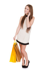Woman With Shopping Bags Talking On Cell Phone
