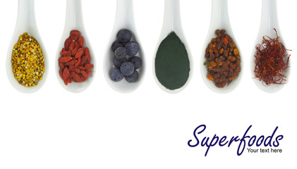 Superfoods in porcelain spoons