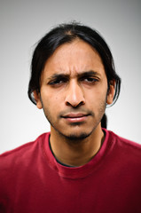 Young Indian Ethnic Man Squinting Portrait