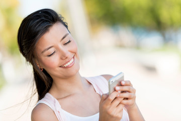 Woman texting on a smart phone