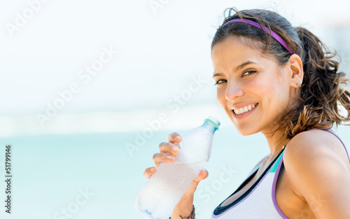 Sports woman drinking water