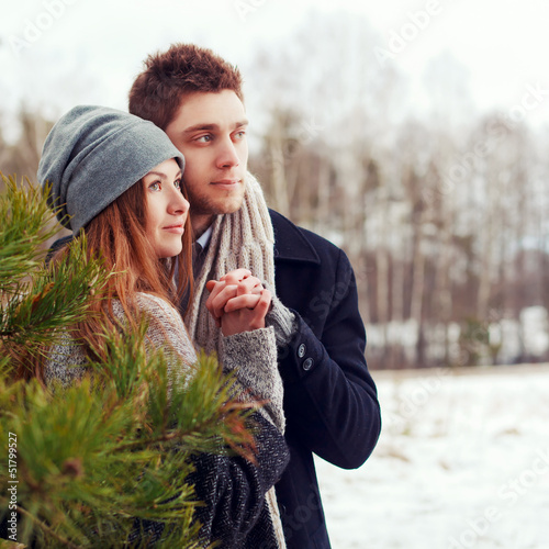 Outdoor sensual portrait of young beautiful couple in love