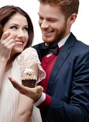 Man presents birthday cake to his pretty girlfriend