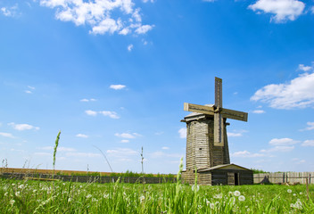 Beautiful view of traditional wooden windmill in russian village