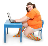 An obese student girl typing on the laptop.