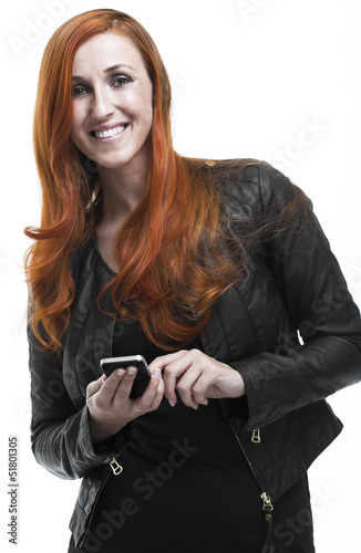 Smiling redhead woman using a mobile phone