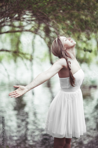 Beautiful woman rejoicing in the joys of nature