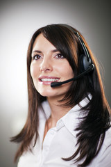 Beautiful call centre operator taking a call