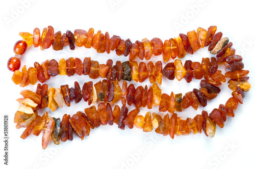 Beads of raw amber on white
