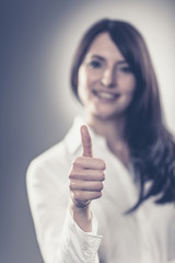 Woman making a thumbs up sign