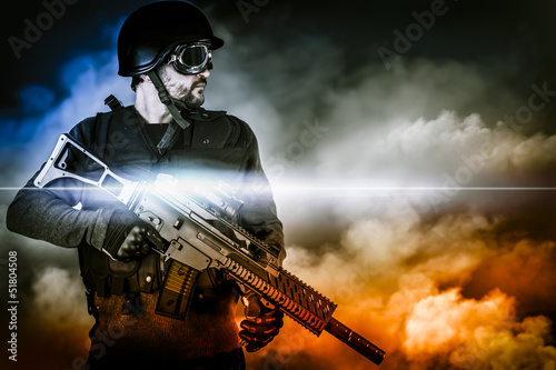 assault soldier with rifle on apocalyptic clouds