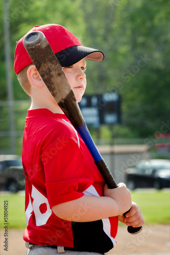 Portrait of child preparing to bat during baseball game