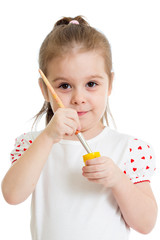 kid girl with brush in paint isolated