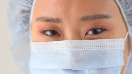 Closeup Chinese woman doctor in surgical mask