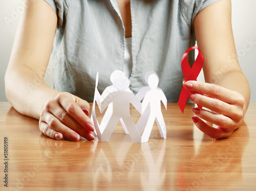 woman taking care about paper people and aids