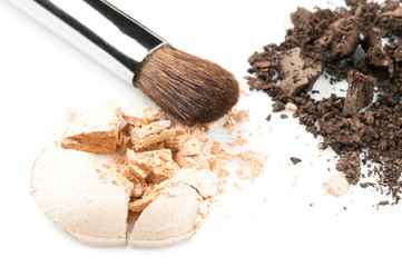 Close up of a crumbled eyeshadows with brush