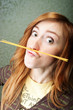 Funny young woman with spaghetti mustache
