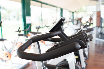 Bycicles and other fitness equipment in gym.