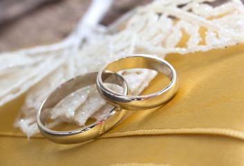 wedding rings on the yellow silk