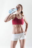 Young Woman Hydrating After Exercise poster