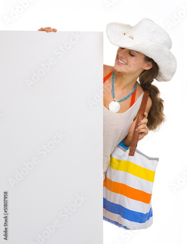 Beach young woman looking on blank billboard