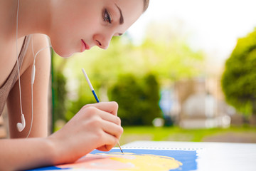 Girl with brush painting an art image