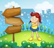 A little girl standing beside the wooden arrow boards