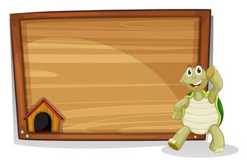 A turtle beside a wooden empty board