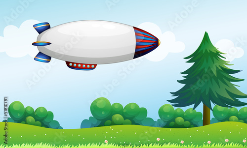 An airship above the hills