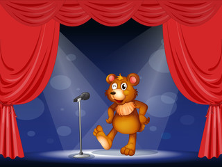 A stage with a bear performing
