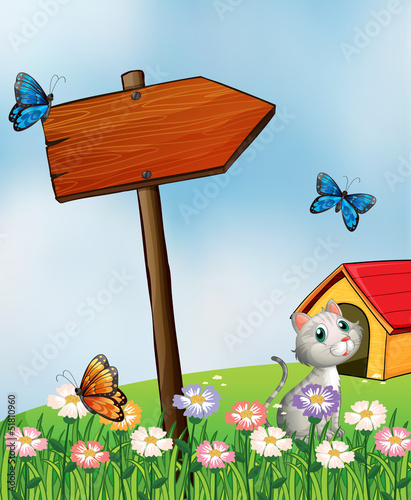 A garden with butterflies and a cat near an arrowboard