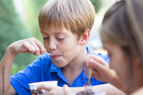 Little children eating ice-cream