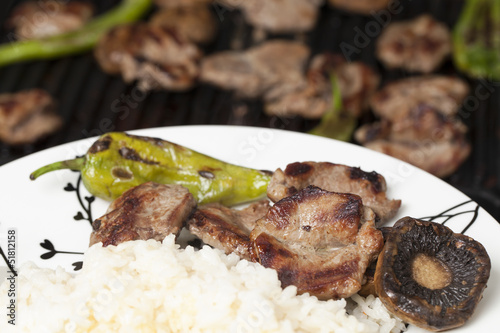 grilled lamb chop with garniture in plate