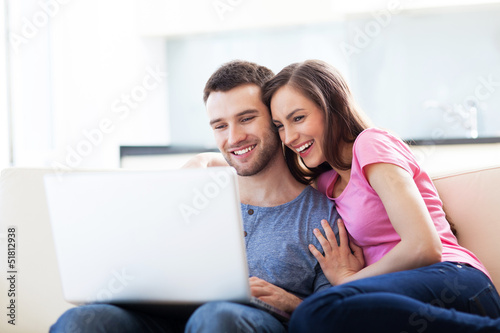 Couple on sofa with laptop