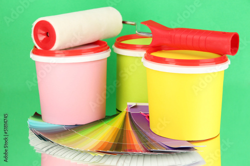 Set for painting: paint pots, paint-roller, palette of colors