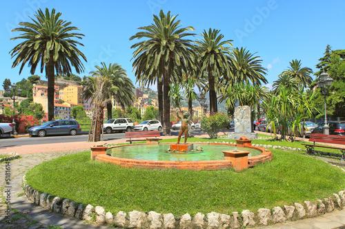 Small fountain with sculpture in Ventimiglia, Italy. - 51816145