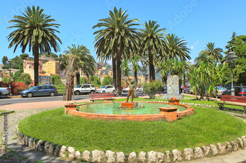Leinwanddruck Bild Small fountain with sculpture in Ventimiglia, Italy.