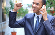 happy young african american businessman on mobile phone