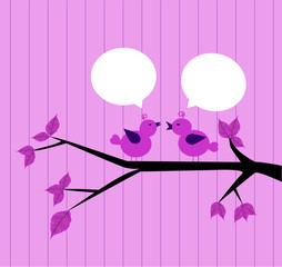 coppia di uccellini chiacchierano sul ramo