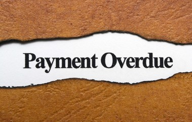 Payment overdue text on torn paper