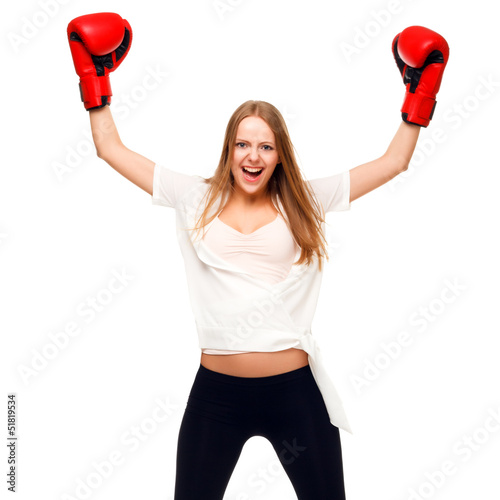 Woman celebrating with arms up wearing boxing gloves - isolated