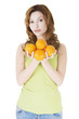 Happy woman with orange fruits